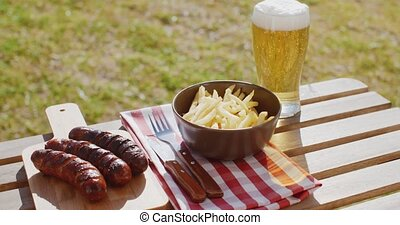 Three tasty smoked grilled sausages with chips - Three tasty...