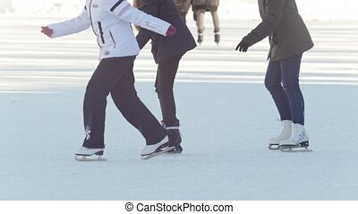 Three teen girlfriends learning to skate and having fun
