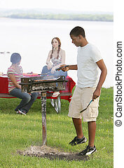 Three Teenage Friends Having a Barbecue