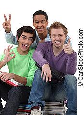 Three teenagers grimacing