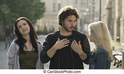 Three teenagers tourists being shocked and scared seeing...