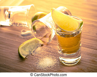 Three tequilas - Three shots of tequila with lime and salt