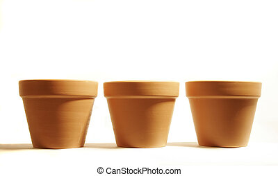 three terra cotta flower pots