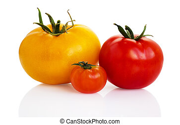 Three tomatoes of different colors and different sizes...