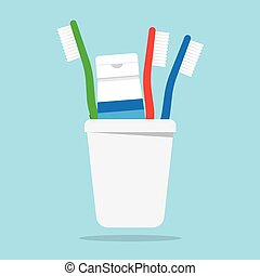 Three toothbrushes and toothpaste in a glass