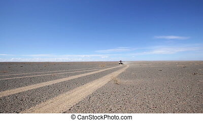 Three tourist jeep ride through the desert