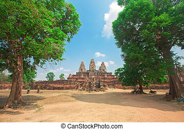 Three towers and long stairs of ancient temple in Angkor. Cambodia