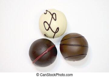 Three Truffles - Three truffles of different types on a...