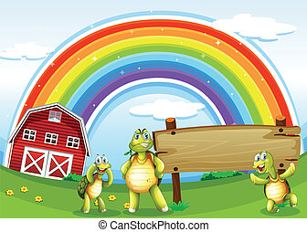 Three turtles near the wooden signboard and the rainbow -...