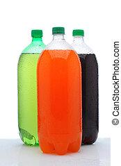 Three Two Liter Soda Bottles on Wet Counter - Three plastic...