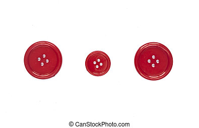 Three Various red sewing buttons isolated on background