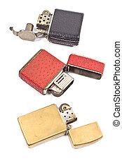 Three vintage lighter isolated on white