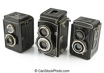 Three Vintage two lens photo camera isolated on white