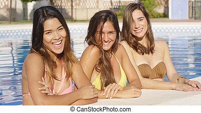Three vivacious gorgeous young women