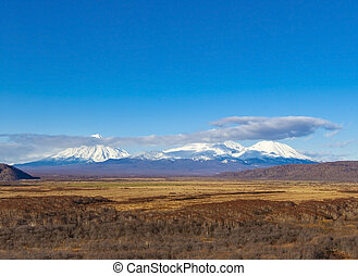 three volcanoes in Kamchatka Peninsula - The three snow ...