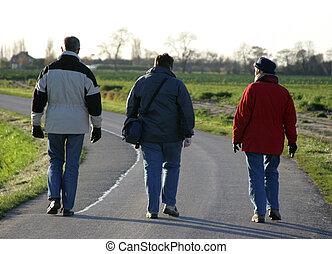 Three people walking together