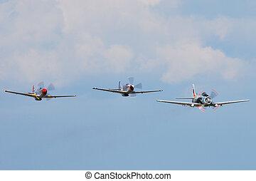 trio of war planes in flight
