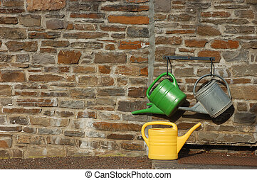 watering cans - Three watering cans on the wall