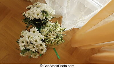 three wedding bouquets in a room