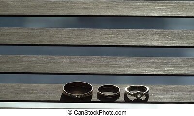 Three wedding rings jewelry at blue background