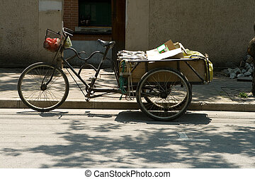 Typical three wheeled bike/trike used to transport almost anything in China.