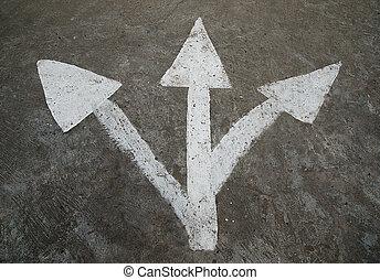 Three white arrow on the road