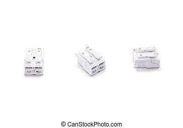 Three white electronic components isolated on white. Compact...
