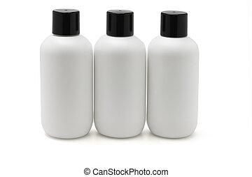 Three white plastic bottles
