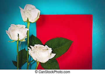 Three white roses with red card