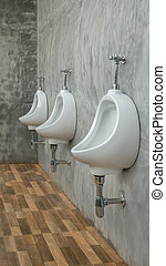 three white urinals