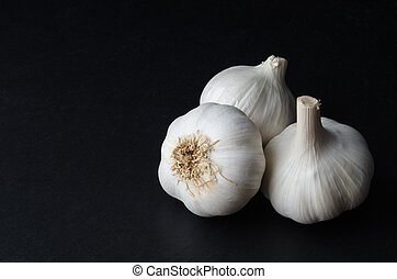 Three Whole Garlic Bulbs on Black