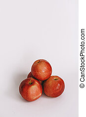 three whole red apple on a white background