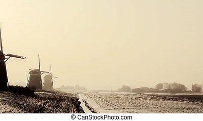"""Three windmills in the orange wintersun. - The """"Three Mills""""..."""