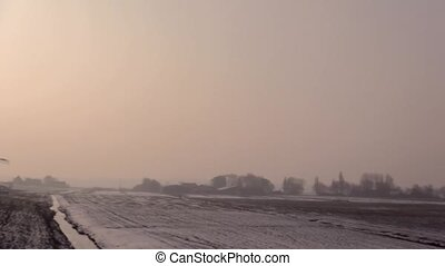Three windmills in the winter.