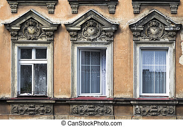Three windows in an old house