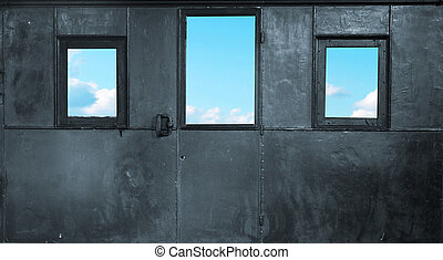 Three windows in the metal room