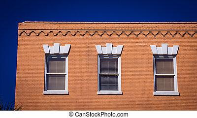 three windows on a building
