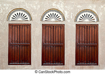 Three Windows on an Arabic old Wall in heritage village in...