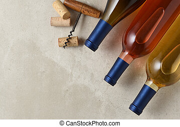 A group of three differetn wine bottles from a high angle....