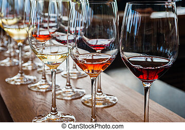 Three wine glasses with samples on wood counter - Three wine...