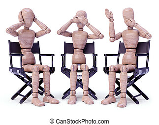 Three wooden dolls sitting doing bodily gestures. Concept of the three wise monkeys.