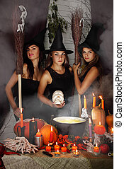 three witch with a skull