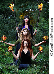 three witches with balls of fire