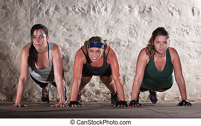 Three Women Do Push Ups in Boot Camp Workout - Sweating...