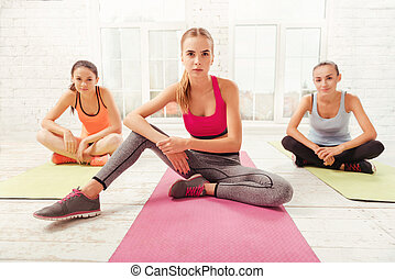 Three women having rest at gym