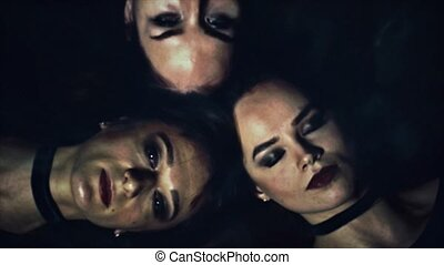Three women horror style portraits. After opening eyes they...