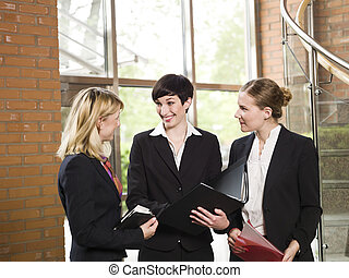 Three women in a business meeting