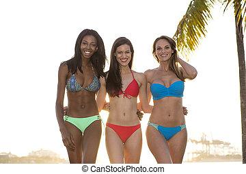 Three women in bikini walking