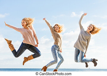 Three women jumping