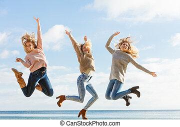 Three women jumping